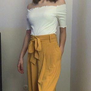 Long, flared mustard pants
